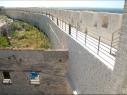Tramo de la muralla junto a la puerta de Las Cuevas después de su restauración.